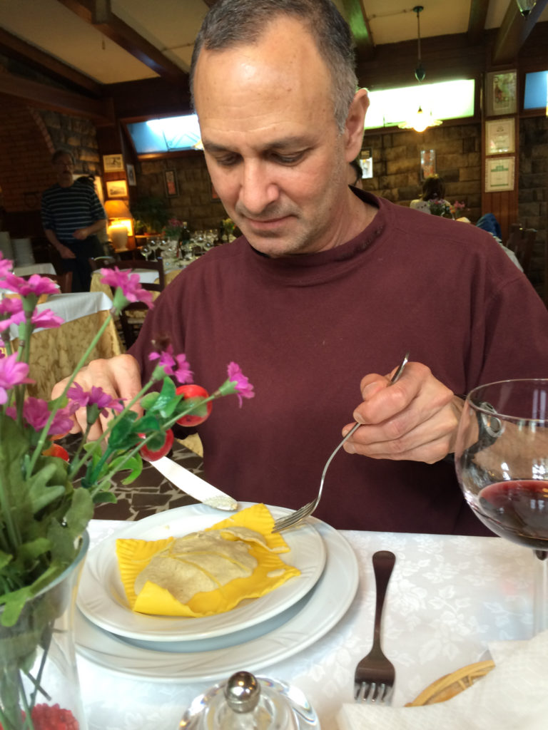 Man eating one large lemon ravioli