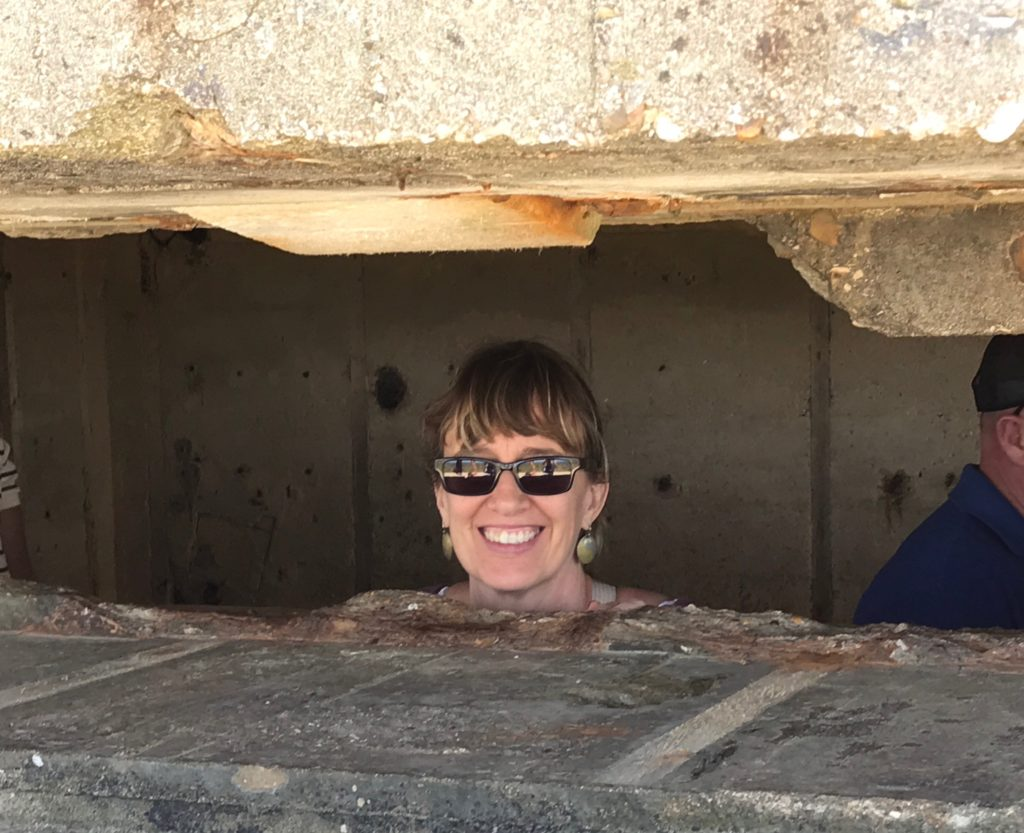 D-Day tour from Bayeux: Chris peering out from inside the German bunker