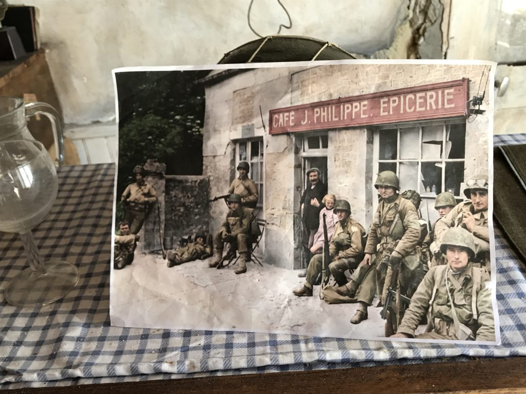 Photo of soldiers leaning against the cafe during WWII