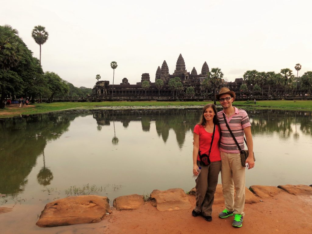 Sara and her husband in front of beautiful Angkor Wat in Cambodia