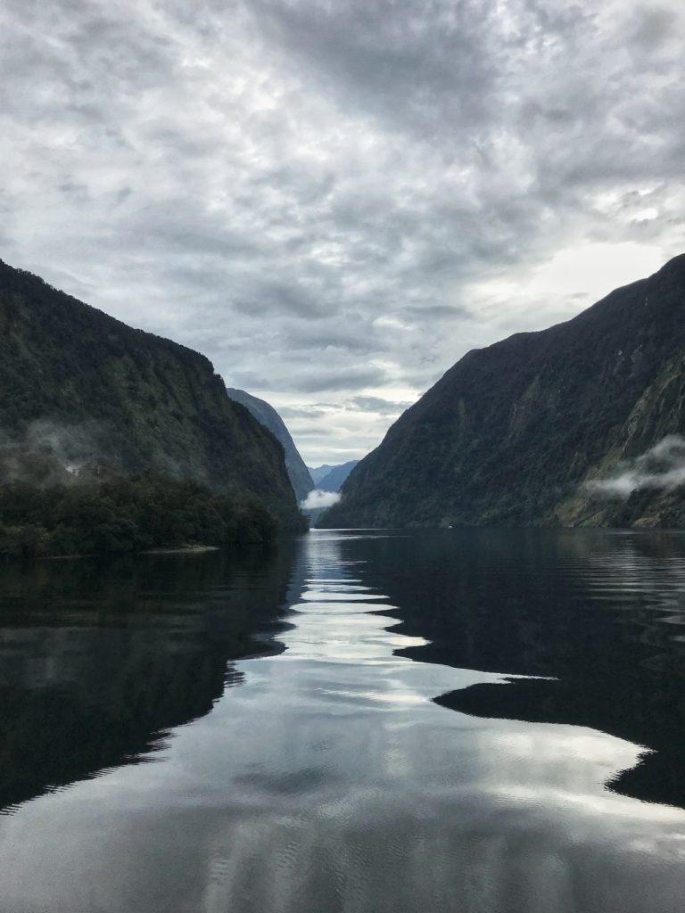Photo of the still waters on a cloudy day during our Doubtful Sound overnight cruise