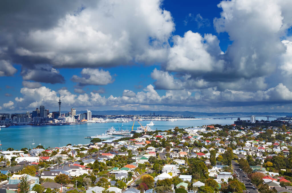 Auckland skyline with ocean and clouds