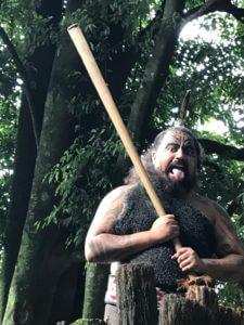 Maori man in traditional dress with facial tattoo