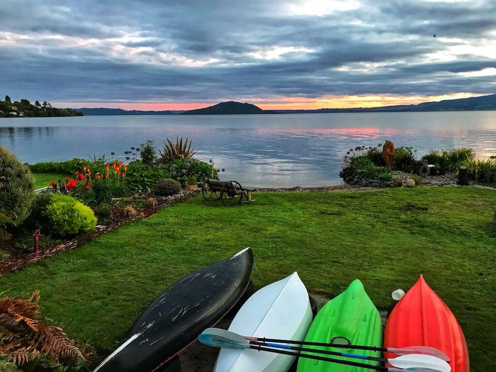 colorful kayakas on the short of Rotorua Lake