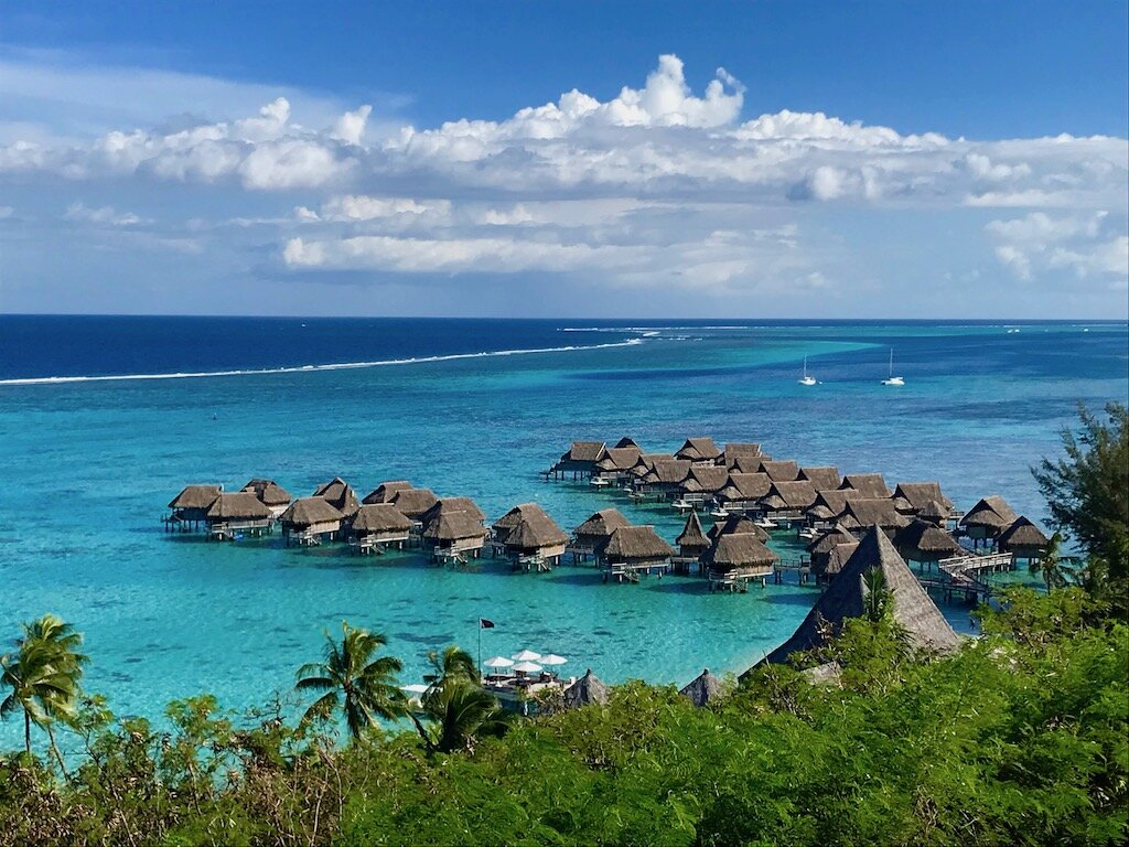 overwater bungalows and a turquoise sea on Moorea