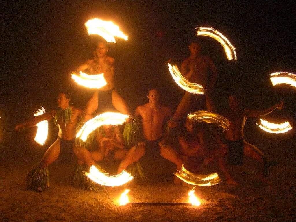 male polynesian dancers dancing with fire