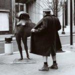 A man flashing a statue.