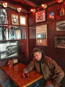 Man having a beer in a cozy pub