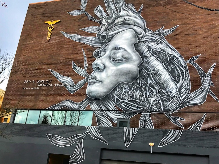 Mural on a brick building of a woman's face