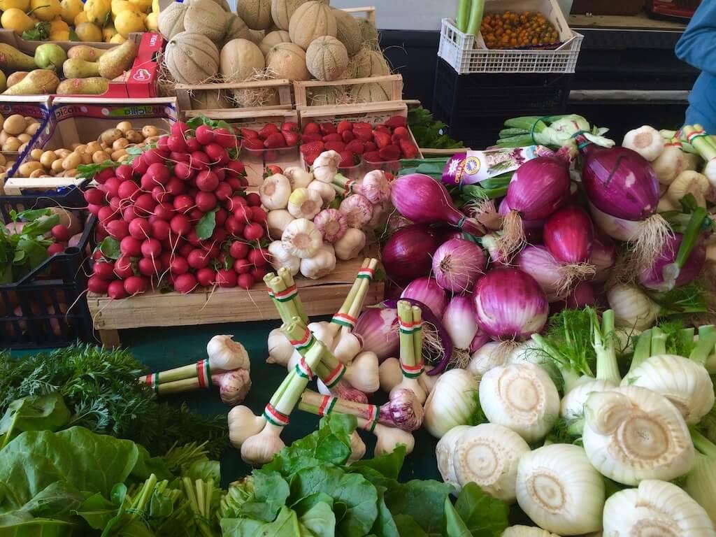 radishes, onions, cantaloupes at the Poggibonsi Market