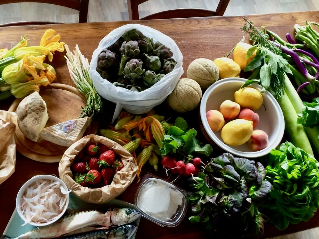 Tuscan produce on a wooden kitchen table