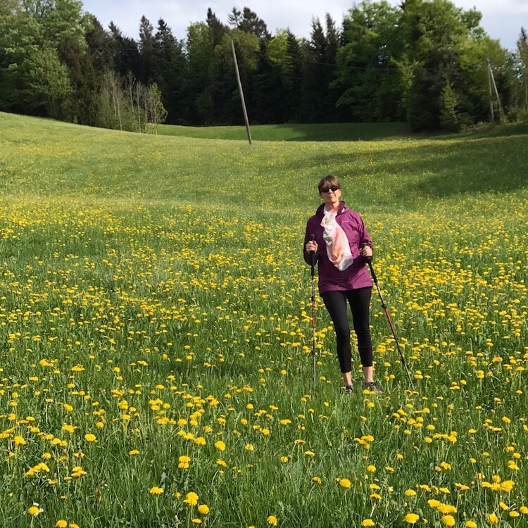Woman in a field of yellow wild flowers