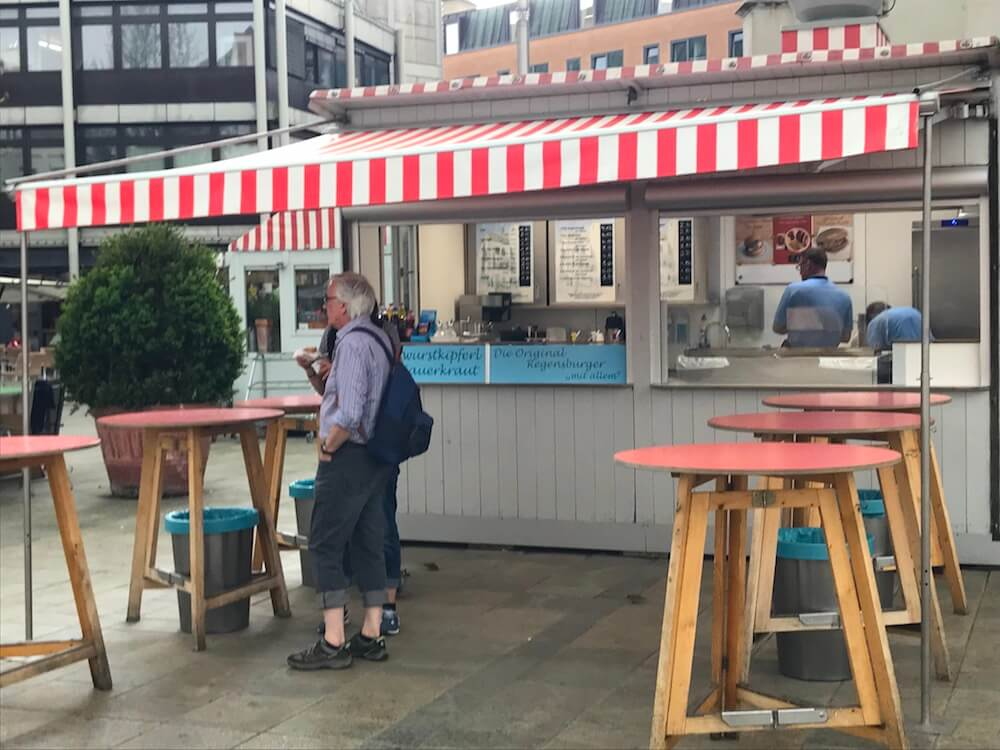 food stand with red and white awning in Haidplatz
