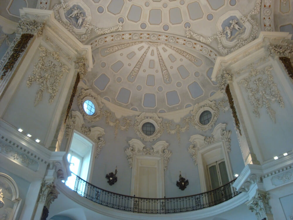 a white rocoo ceiling of the palace on Isola Bela