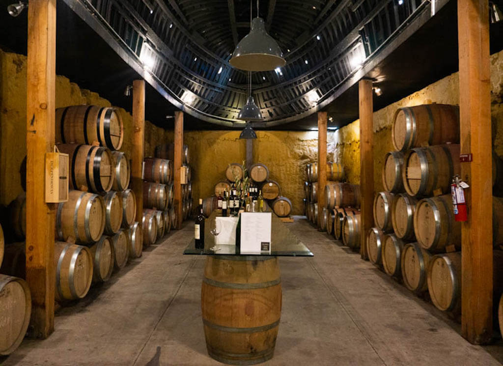 barrels stack inside Vena Cava Winery