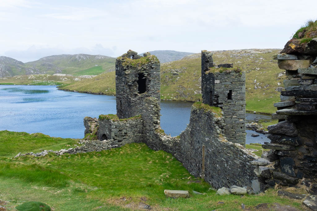 castle ruins above a lake