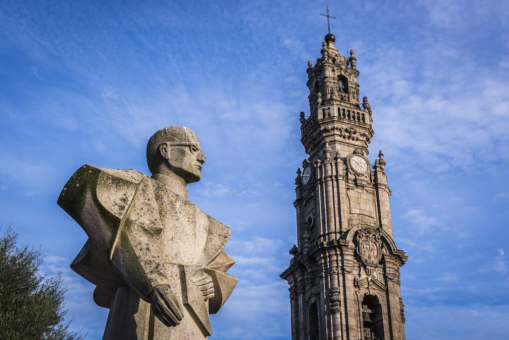 Antonio Ferreira Gomes monument and famous Clerigos Tower in Porto, Portugal
