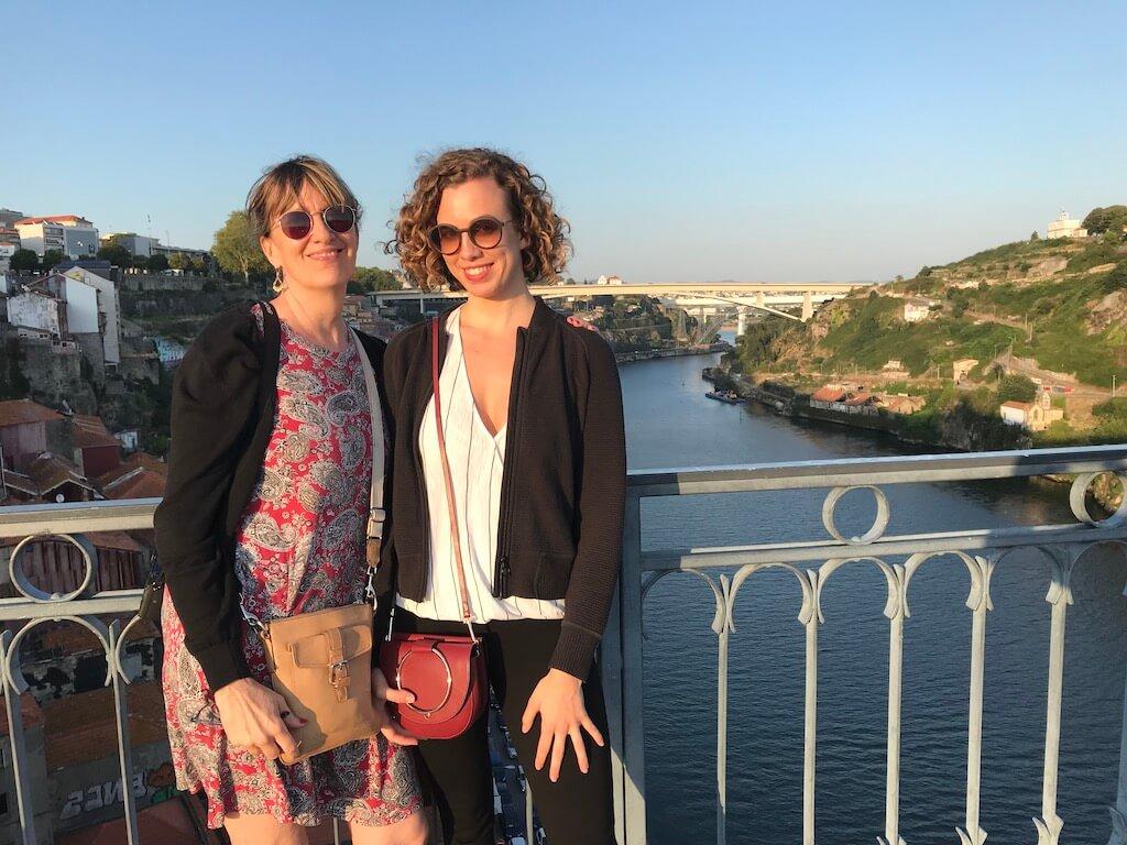 Two women on a bridge in Porto