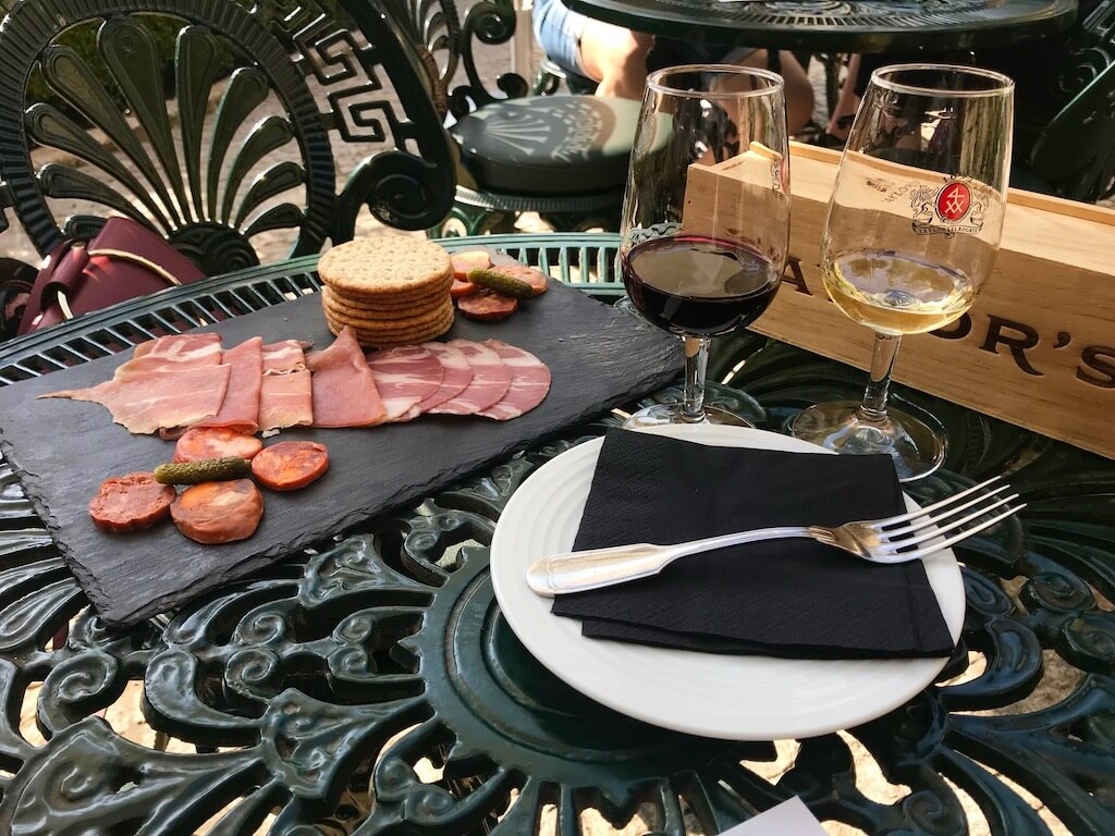cheese, salami and two glasses of Port in the garden