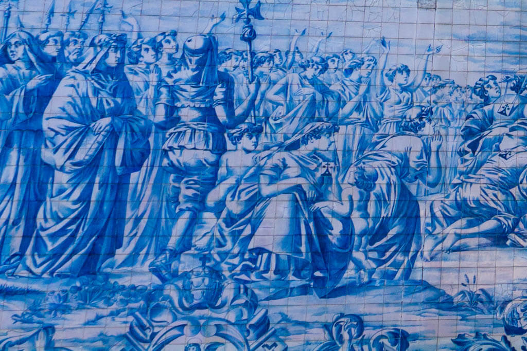 close up of intricate painting on traditional Portugues blue and white tile