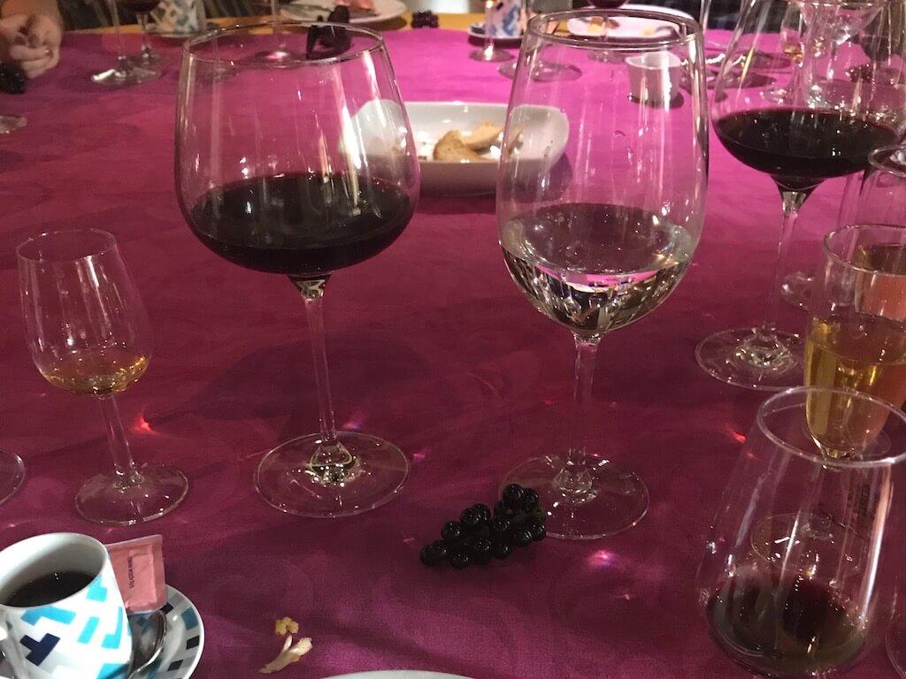 wine glasses on a fuschia colored table cloth