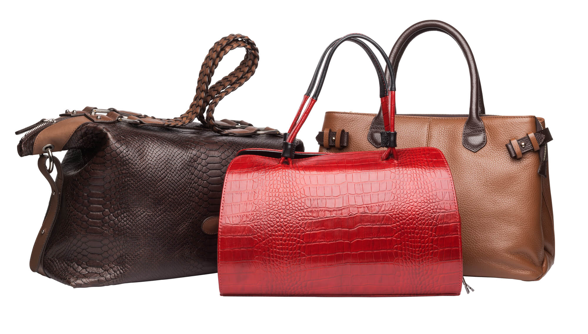 red, brown, and tan leather purses