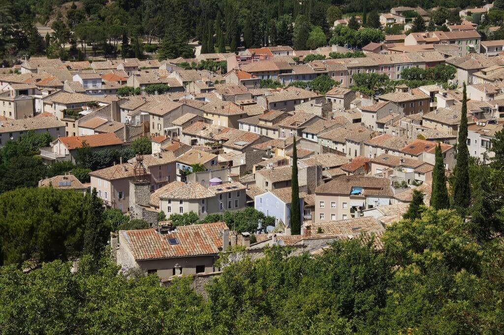 Looking down on a cluster of tile roofs in the village of Vaison-la-Romaine