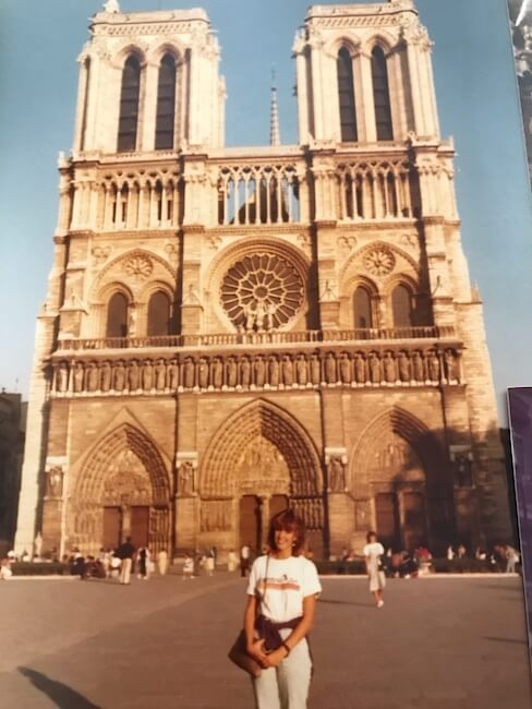 girl in front of Notre Dame Cathedral in Paris in 1985