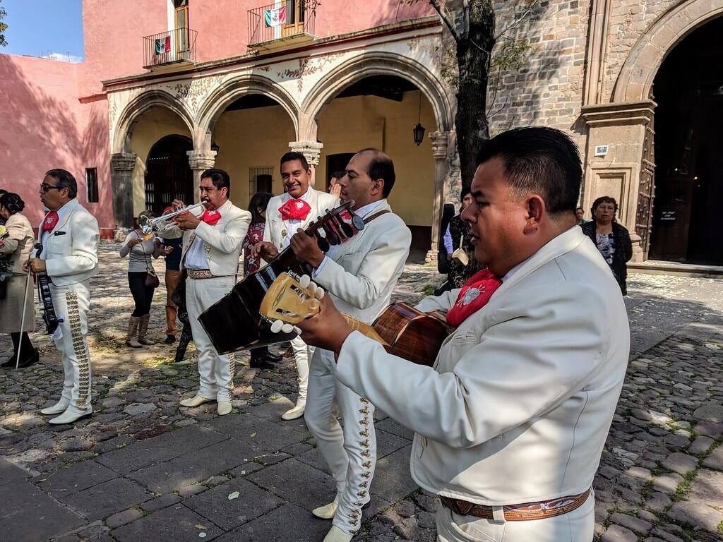 Mariachi players in white uniforms