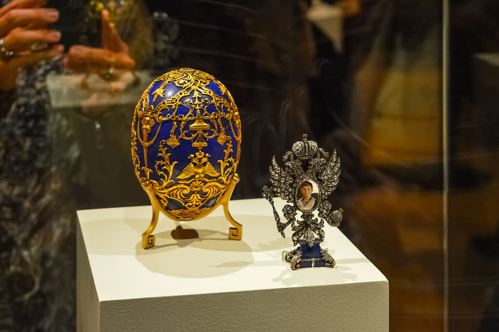 photo of an ornate blue and yellow faberge egg