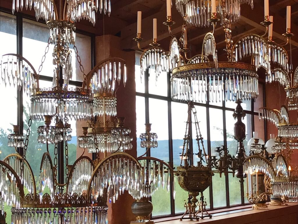 many chandeliers next to a window