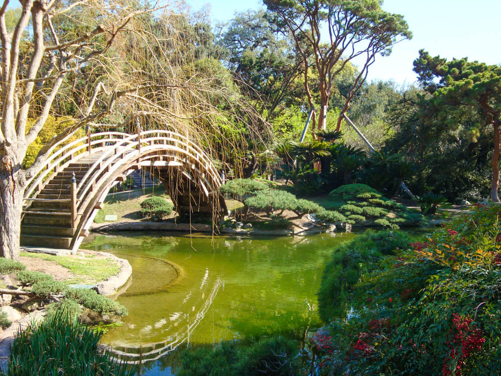 Japanese bridge reflected in the water at Hungtington Gardens in Pasadena