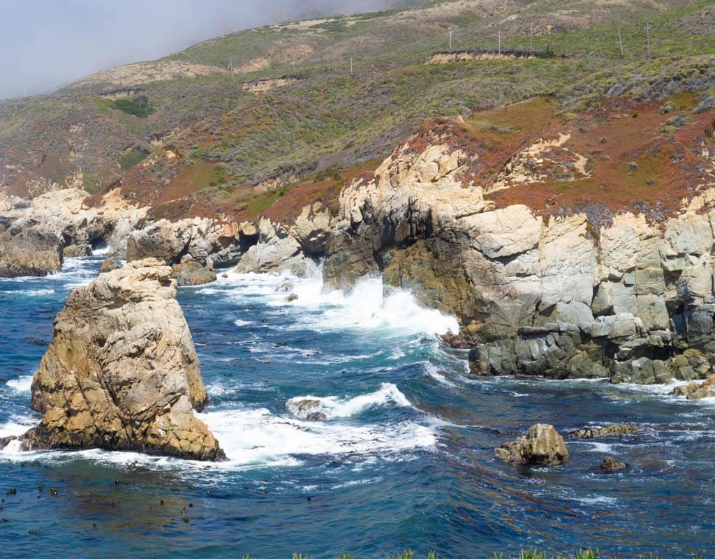 waves crashing on rocks of Big Sur coastline