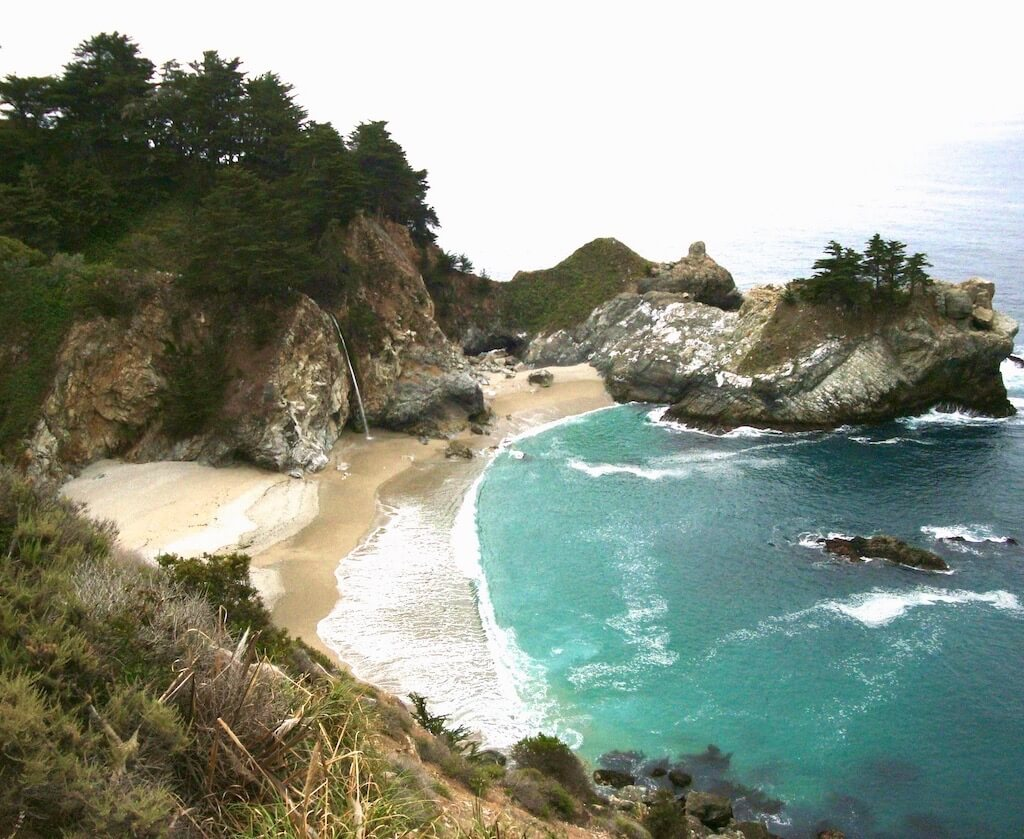 waterfall on the beach at McWay Falls, one of the best things to do in Big Sur!