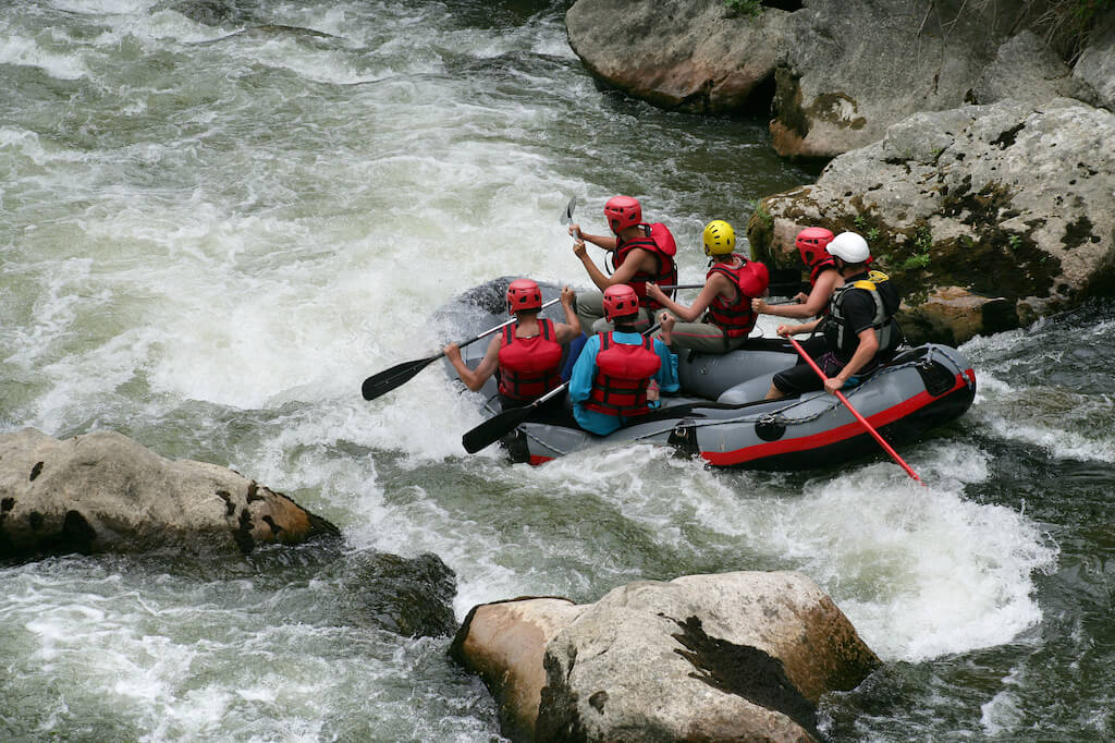 group of people river rafting