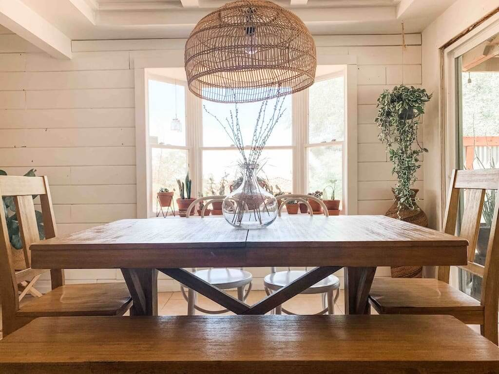 wooden dining table in a room