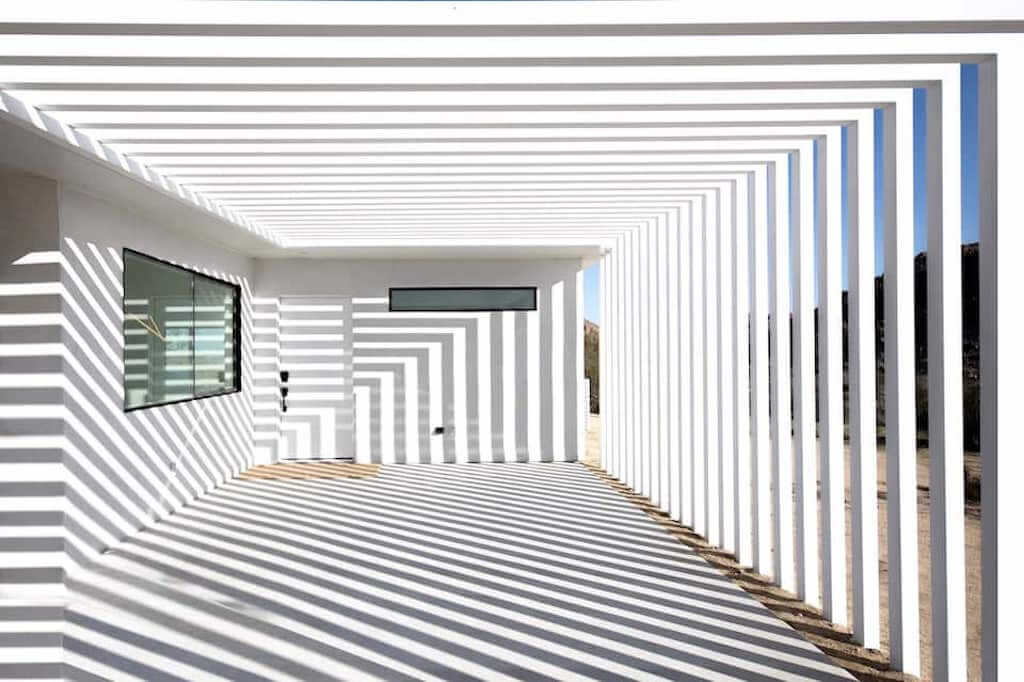 striped shadows in outdoor courtyard