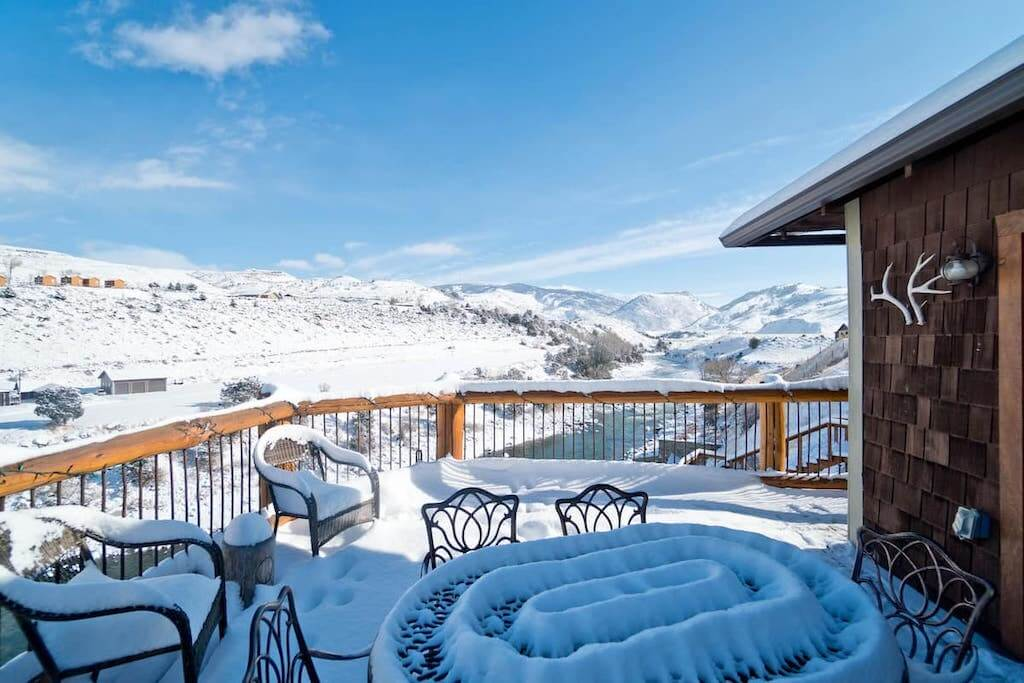 snow covered cabin deck