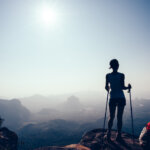 female hiker standing on a mountain