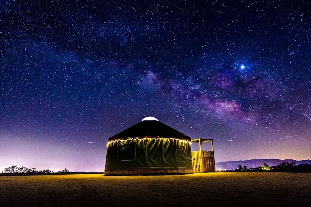 yurt exterior under starry sky