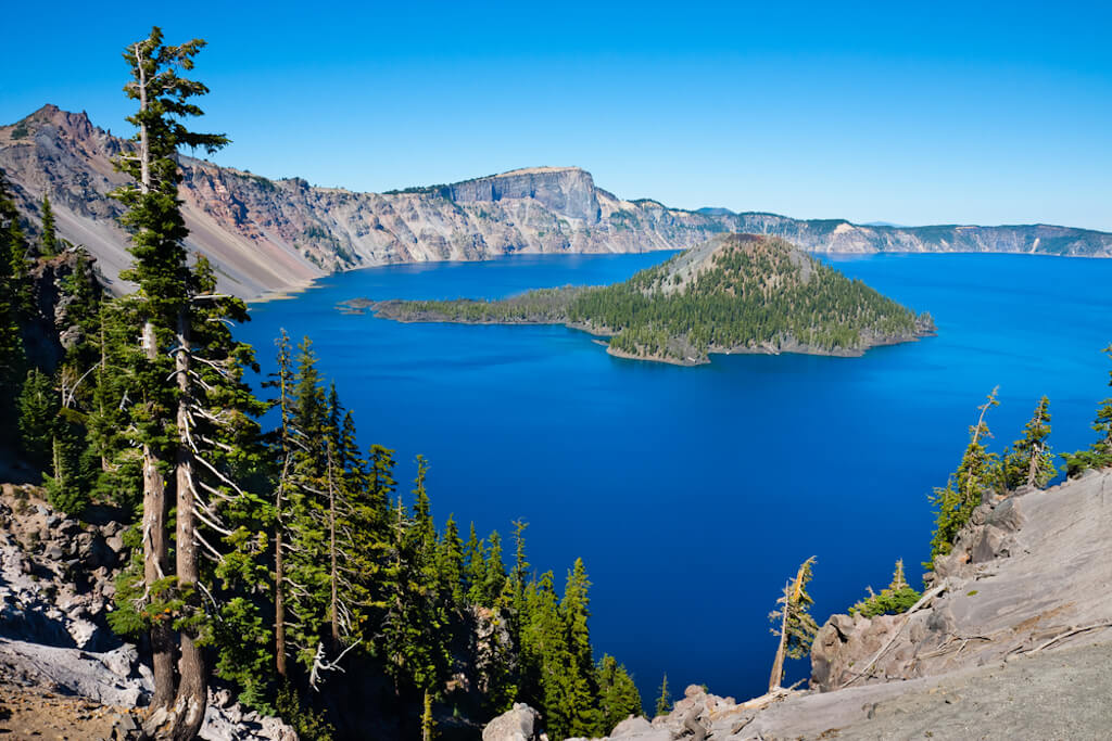 panoramic view of Crater Lake with pine trees
