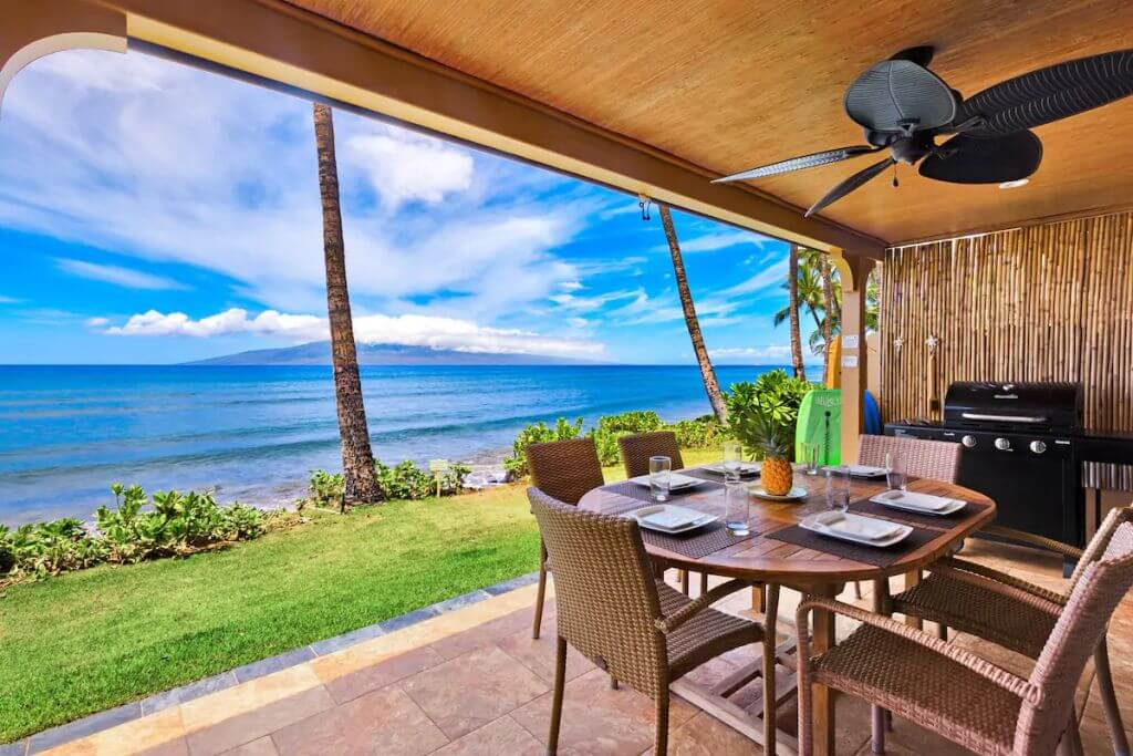 view of dining outdoor patio with ocean view