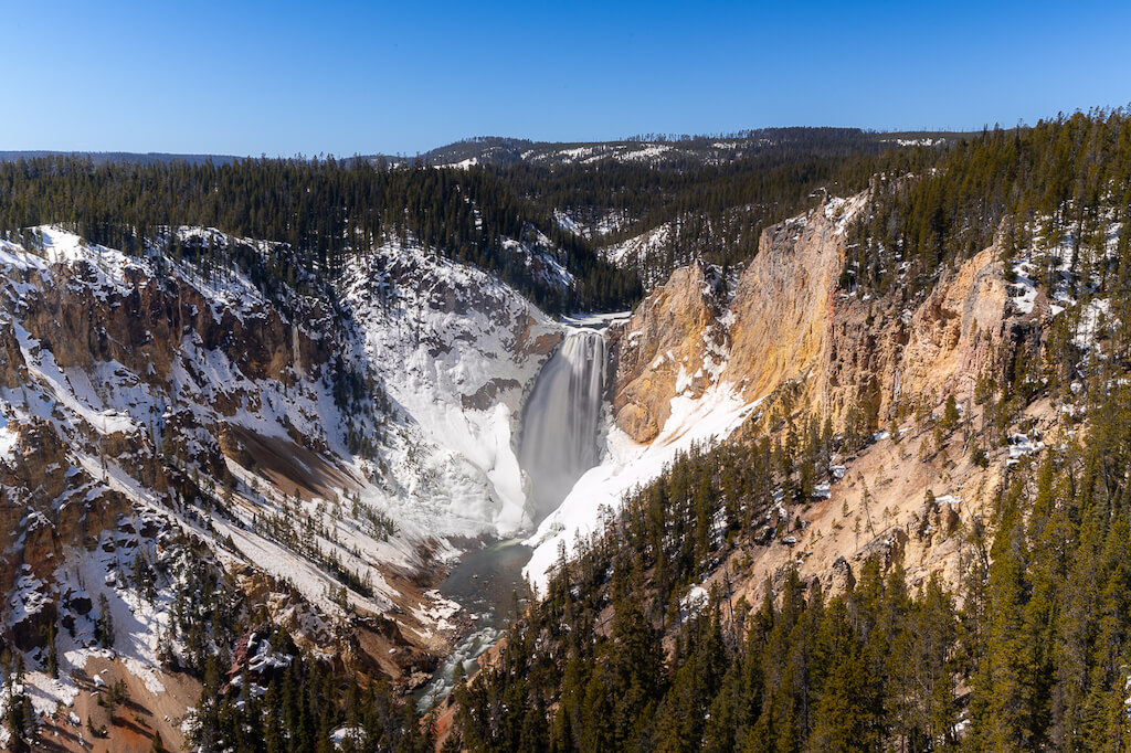 Waterfall at Grand Canyon of the Yellowstone with snow