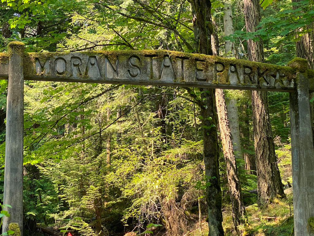 Moran State Park sign covered in moss