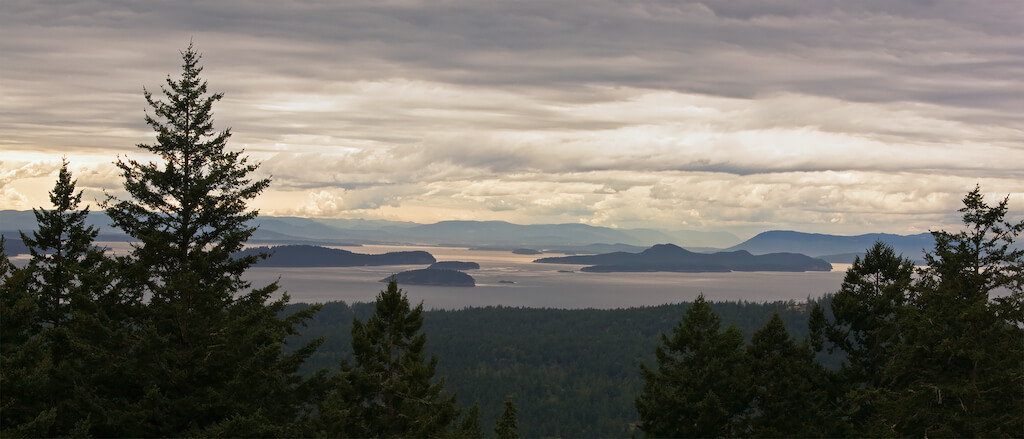 A beautiful panorama of the San Juan Islands, in northwest Washington, on an overcast afternoon. Canada's Vancouver Island is visible in the distance.