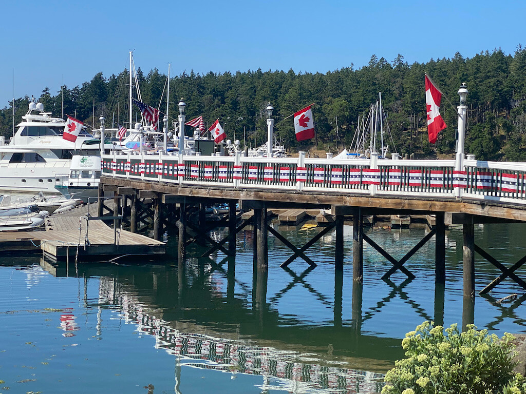 boats at Roche Harbor with red and white blue streamers on 4th of July