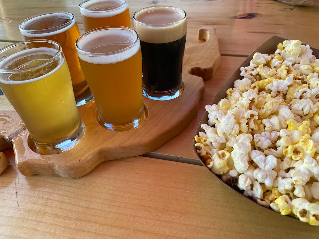 flight of five beers with popcorn