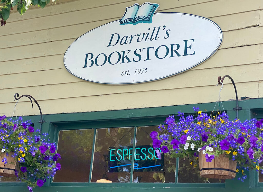 bookstore sign with flower baskets