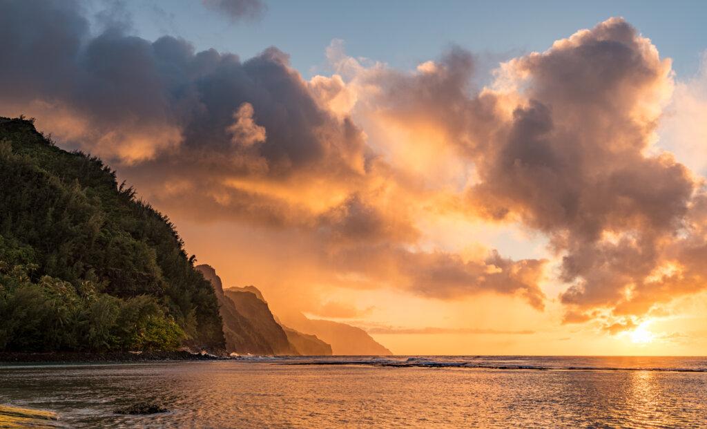Sunset lights the receding cliffs of the NaPali coastline on north coast of Kauai in Hawaii