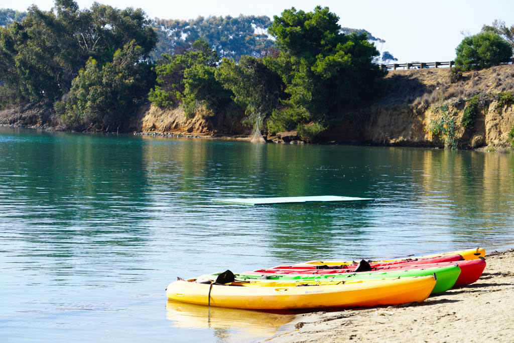 kayaks at edge of lagoon